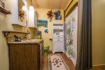 The bathroom has a shower/tub combo and is located in the hallway between the two bedrooms.