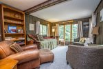 The living room is great for curling up with a good book, there are lots in the home`s library.