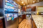 This open kitchen also has a dishwasher- no need to hand wash dishes during your vacation.