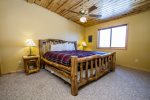 The master bedroom has a king bed and views of Gunflint Lake.