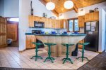 Step up to the tractor seat bar stools at the kitchen counter- a great place to enjoy breakfast.