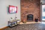 This room features a Roku TV and wood burning fireplace.