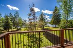 Enjoy views of the spacious back yard and Devil Track Lake.