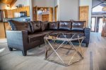 There`s plenty of seating for everyone to sit back and reconnect to what`s important in the living room area.