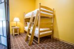 Twin over twin bunk beds are perfect for kids or a group of friends who each want their own bed.