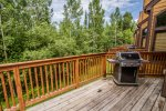 The gas grill on the deck is perfect for summertime BBQs.