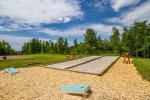 Play a game of corn hole or bocce ball in the community areas.