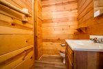 The cabin has a full bathroom with running water.