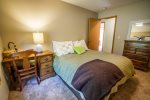 The second guest bedroom, located on the main level, has a full sized bed.