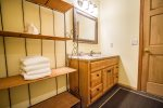 The second guest bathroom is spacious and includes a vanity.