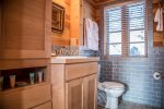 Even the bathroom is bright and cheerful and full of custom wood cabinetry.