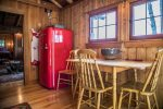 The kitchen includes apartment-sized appliances including a vintage-style fridge, range, and dishwasher.