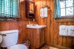 The cabin has one bathroom that is also shared with the loft space. The bathroom has a walk-in shower.