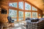 A literal wall of windows in the living room grants you sweeping views of Clearwater Lake and its many majestic bluffs.