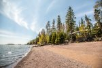 Agate Bay sits on a truly unique stretch of sandy shoreline with views of Artist`s Point and downtown Grand Marais in the distance.