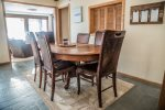There is seating for six at the dining room table which has a pass-through into the kitchen for easy serving.