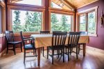 There`s room for everyone at the dining room table- plus incredible views of Birch Lake.