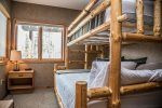 In the lower level there are two bedrooms- Guest Bedroom 1 has a twin over queen  bunk bed.