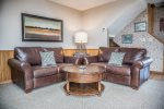 The living room has two love seat couches- great for relaxing after a long day of skiing.