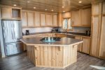 The kitchen has custom cabinetry and plenty of room for multiple cooks.