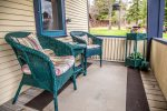 Sit on the home`s front porch and enjoy the sites and sounds of Grand Marais in the summer.
