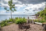 Sit on the ledge rock beach or gather around the lakeside firepit to enjoy the natural beauty surrounding the home.