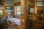 The bathroom located in the master bedroom features a soaker tub and a separate walk-in shower.