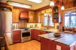 The kitchen features stainless steel appliances and a butler`s pantry with a wine cooler.