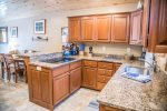 The kitchen space is complete with granite countertops and supplies for you to show off your cooking skills.