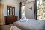 Unpack and unwind in the guest bedroom.