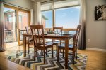 Enjoy a family meal at the dining room table.