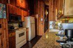Enjoy this beautifully remodeled kitchen featuring solid wood cabinets and granite counter tops.