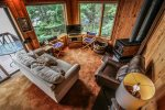 The cozy living room is a great place to curl up and watch a movie after a long day of exploring the North Shore.