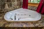 Enjoy soaking in the master bathroom`s jetted tub after a long day of exploring the North Shore.