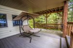 Relax in the swinging recliner on the covered deck space.