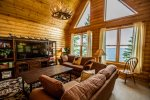 The living room also features vaulted ceilings and floor to ceiling windows to take in the Lake Superior views.