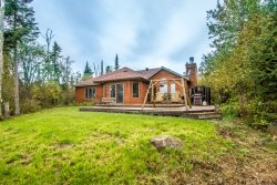 Bay Breeze is a beautiful Hovland vacation home rental along the shoreline of Lake Superior that is the modern version of warm and cozy.