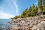 Asle Ta is a true gem located on Cascade Beach Road, sitting just feet away from Lake Superior.