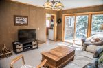 The cozy living room is set off of the kitchen and a great place to sit back and relax.