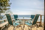 The deck is the highlight of this beautiful property- this spot is perfect for sitting out with your morning coffee.