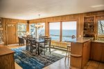 The living area features an open kitchen and living room area, complete with a wall of windows to enjoy the Lake Superior views.