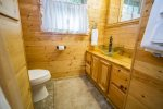 The first bathroom also has a beautiful vanity- the one touch of modern you will find in this historic cabin.