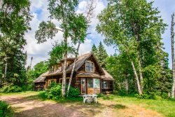 Deer Creek will transport you back in time at this one-of-a-kind historic log cabin in Lutsen with pristine shoreline.