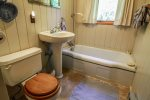 The second bathroom, also on the main floor, has a hand held shower head/tub combo no actual shower.