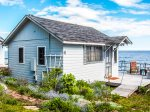 This quaint vacation rental cabin is located on popular Croftville Road.