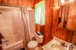 The second section features a full bathroom with a shower/tub combo, accessible through the attached half bath and the attached master bedroom on the other side.