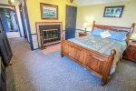 The master bedroom has amazing Lake Superior views and a private wood-burning fireplace.