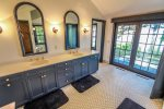 Enjoy the massive dual vanity in the master bathroom.
