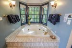 The deep soaker jetted tub in the master bathroom is great for relaxing after a long, active day on the Northshore.