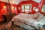 The four poster bed and window seat make this a popular bedroom.